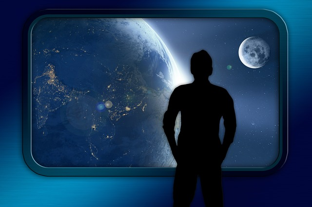 man looking out of spaceship
